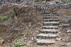 Old stone stairs up hill Stock Image