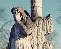 The old stone statue of an angel headstone in the cemetery in vi Stock Photography