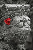 Old stone statue of Balinese god Stock Photography