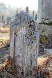 The old stone statue without head at the cemetery in Ukraine Stock Photography