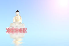 Old stone statue of meditating Buddha on blue water Royalty Free Stock Photos