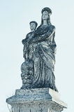 Old stone statue of the Virgin on tomb and Jesus Christ in the c Stock Photos