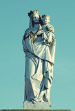 Old stone statue of the Virgin on tomb and Jesus Christ Crowned Royalty Free Stock Image