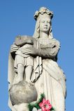Old stone statue of the Virgin on tomb and Jesus Christ with rol Stock Photography
