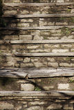 Old stone steps. Worn down and cracked royalty free stock photo