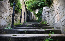 Old Stone Steps Alley. Low Angle View of Old Stone Steps Leading up a Narrow Alley Stock Photo