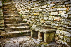 Landmark attraction in Bulgaria. Old stone steps - Botanical Garden from Balchik. Landmark attraction in Bulgaria. Bench and steps carved in stone at the stock image
