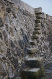 Old Stone Steps the Cobb. Old stone steps leading up to walkway known as the Cobb Lyme Regis Devon royalty free stock photography