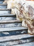 Old Stone Steps. Old patinated blue stone bullnose steps, with side wall made from large rough sandstone blocks Stock Photos