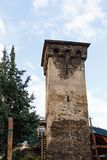 Old stone svan tower on street of Mestia city in Svaneti, Georgia. Sky with clouds background. royalty free stock photo
