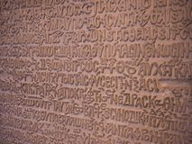An old stone tablet with antique relief writing royalty free stock photos