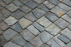 Old stone tiles roof background Royalty Free Stock Photos