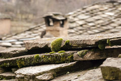 Old stone tiles roof closeup Stock Photo
