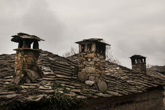 Old stone tiles slide-roof house Royalty Free Stock Photo