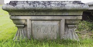 Old stone tomb with engraved text Royalty Free Stock Images