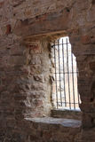 Old stone tower cell. Old stower rock and bar cell Royalty Free Stock Image