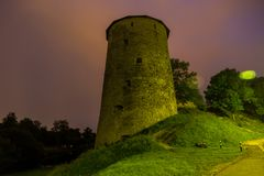 Old stone tower of medieval fortress at night. Pskov, Russia stock photography