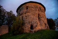 Old stone tower of medieval fortress at night. Pskov, Russia.  Royalty Free Stock Photos