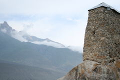 Old stone tower in the misty mountains Stock Photography