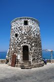 Old stone tower, Nisyros. An old stone tower on the seafront at Mandraki on the Greek island of Nisyros Stock Images