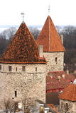 Old stone tower under a red tile Stock Photography