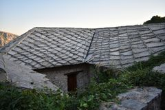 Old stone traditional house with the stone slab roof. Počitelj,Bosnia and Herzegovina stock photos