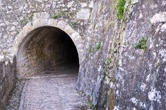 Old stone tunnel of fortress from the outside Stock Photos