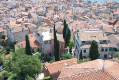 Old stone village with sea of roofs in background. Old mediaeval village streets and red Mediterranean roof in Croatia (Rovinj) with sea in background, seen form Royalty Free Stock Images