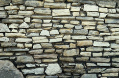 Old stone wall. Fragment of old wall made of irregular shaped stones Royalty Free Stock Image