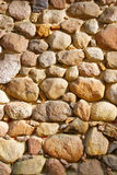 Old stone wall. With big and small pebbles Royalty Free Stock Photography