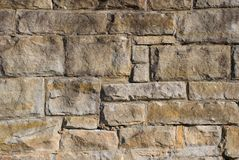 An old stone wall. A close up of an old stone wall made from huge blocks of sandstone Stock Photo