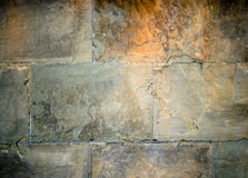 Old stone wall background. An old stone or brick wall as a background royalty free stock photos