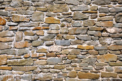 Old stone wall background texture. Old stone wall of the medieval castle stock images