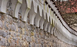 Old stone wall. Beautiful old stone wall wih ornaments stock images