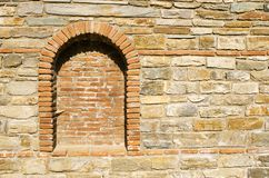 Old stone wall with a brick niche. And web, Athos, Greece Stock Photo