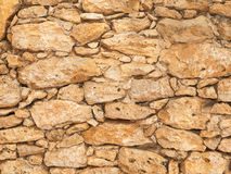 Old stone wall close up in sunny day Royalty Free Stock Images