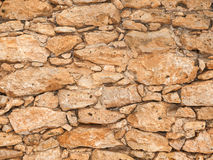 Old stone wall close up in sunny day Stock Photo