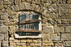 Old Stone Wall. With a closed wooden window Royalty Free Stock Images