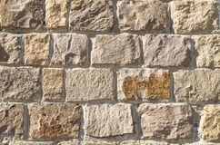 Old stone wall closeup in sun royalty free stock images