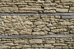 Old stone wall closeup with two beams Royalty Free Stock Photography