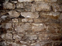 Old stone wall. Detailed view of an ancient stone wal Stock Photography