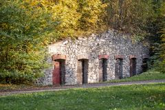 Old stone wall with doors in the park royalty free stock photography