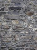 Old stone wall with grey, white and brown colors stock image