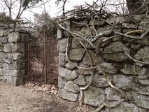 Old Stone Wall with Iron Gate Stock Photography