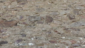 Old stone wall with an irregular pattern stock video footage