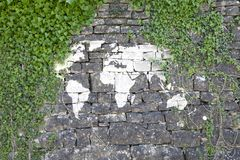 World map illustrated on old rock wall Royalty Free Stock Image