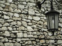 Old stone wall with lantern Royalty Free Stock Images
