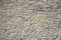 Old stone wall made of limestone and sandstone Royalty Free Stock Photos