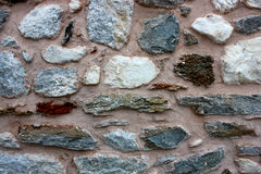 Old stone wall. Old wall made of various colorful stones Stock Photography