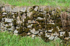 Old stone wall with moss Stock Photo